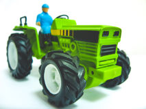 Green toy tractor Royalty Free Stock Image