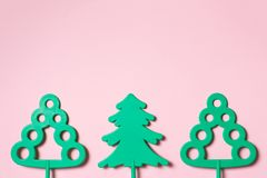 Green toy trees on pastel pink background - word environmental protection day and saving trees and forests concept with copy space royalty free stock image