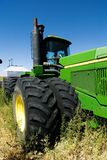 Green Tractor. A large air seeder system being pulled behind a John Deere Tractor Royalty Free Stock Photo