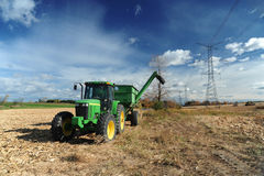 Green tractor in the farm field Stock Photography