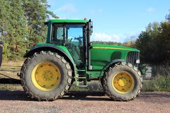 Green tractor by field stock images