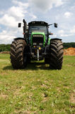 Green tractor on grass. New green tractor on grass Royalty Free Stock Image