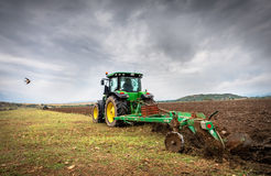Green tractor. Karlovo, Bulgaria - August 22th, 2015: Ploughing a field with John Deere 6930 tractor. John Deere 8100 was manufactured in 1995-1999 and it has Stock Images