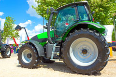 Green tractor. The new tractor exhibited for sale,photography Stock Photo