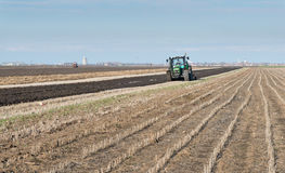Green Tractor Plowing Royalty Free Stock Photography