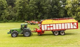 Tractor in the summer field. Green tractor in the summer field. Czech Republic Royalty Free Stock Photography