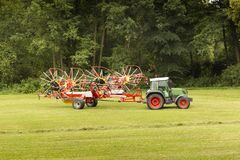 Tractor in the summer field. Green tractor in the summer field. Czech Republic Stock Images