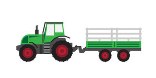 Green tractor with trailer Royalty Free Stock Images