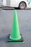 Green traffic cone. In car park Royalty Free Stock Photo
