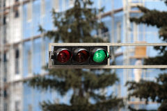 Green traffic light. Traffic lights on metal console above road Royalty Free Stock Images