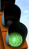 Green Traffic Light. A green traffic light on blue sky Royalty Free Stock Photo