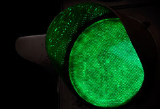 Green traffic light above black background Royalty Free Stock Photos