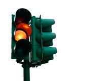 Green traffic light with burning yellow lamp Royalty Free Stock Image