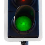 Green traffic light close up. Isolated on white stock image