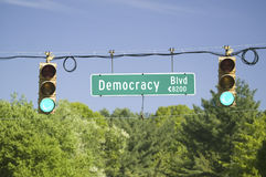 A green traffic light on Democracy Blvd. Symbolizing the thriving Republican Ideal of Democracy in America, Washington, DC royalty free stock image