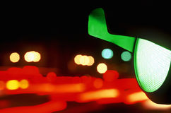 Green Traffic Light at Night. A green traffic light lit up in the night sky royalty free stock photo