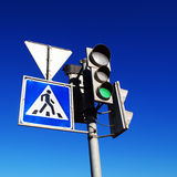 Green traffic light. And pedestrian crossing sign Royalty Free Stock Images