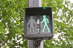 Green traffic light signal sign in street Stock Photos
