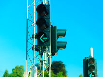 Green traffic lights against blue sky background Royalty Free Stock Image