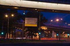 Green traffic lights in evening highway Stock Photos