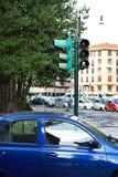 Green traffic lights for pedestrians on crossroads Stock Photo