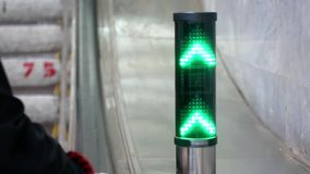 The green traffic lights show the direction of the escalator at the airport.  stock footage