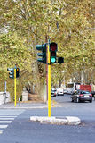 Green traffic lights on street of city Stock Image