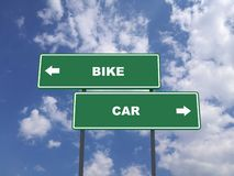 Green traffic sign quote : Bike vs Car stock photography
