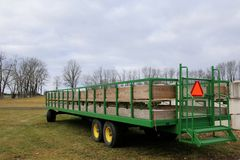 The green trailer. The green trailer o this farm was about to be loaded  up and take some tools to another part of the farm Royalty Free Stock Images