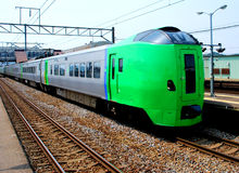 Green train in Japan. Colorful, clean, and fast train in Japan Royalty Free Stock Photo