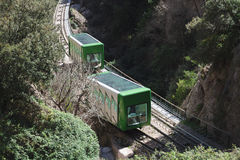 Green train in Montserrat mountain Royalty Free Stock Image