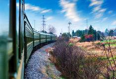 Green train that runs through the countryside Stock Image