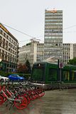 Green tram historic center square Milan Italy royalty free stock image