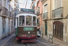 Green tram in narrow - Lisbon Royalty Free Stock Image