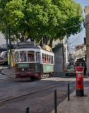 Green tram in narrow,  street, Lisbon Royalty Free Stock Image