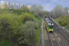 Green tram on the rails. Poznan, Poland - April: Green tram on the rails stock photos