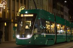 Green tram on a Swiss street at night stock photos