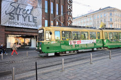 Green tram and urban life cente Royalty Free Stock Images