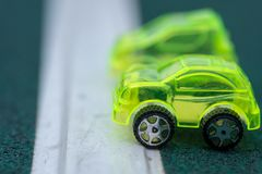 Macro shot of pair of toy cars royalty free stock photos