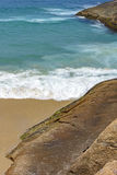 Green and transparent waters. And stones on Devil beach in Ipanema, Rio de Janeiro stock photography