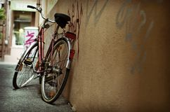 Green Transport. Environmentally friendly mode of transport.  Bicycle leaning against a wall Stock Images