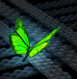 Green Transportation. Concept with a group of city highways full of cars stuck in traffic gridlock and a green butterfly flying over the vehicle chaos as a Stock Image