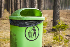 Green trash in forest. Stock Image