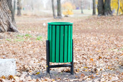 Green Trash Bin in the Park Stock Photo