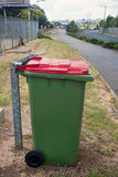 Green trash can in the city Royalty Free Stock Photos
