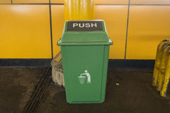 Green trash can made from plastic in public area train station photo taken in Jakarta Indonesia Royalty Free Stock Photo