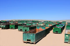 Green trash containers. Rows of green trash containers in the desert Royalty Free Stock Image