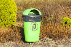 Green trash, plastic bag visible. Royalty Free Stock Photo