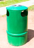 Green trashcan and Ashtray Royalty Free Stock Photos