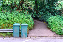 Green trashcan for keeping garbage in public park Royalty Free Stock Photos